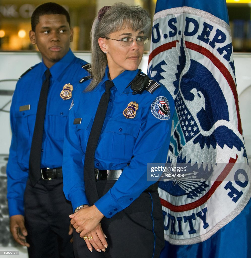 transportation security administrationtsa officers wait for ceremonies to begin wearing the new dark - Transportation Security Officer