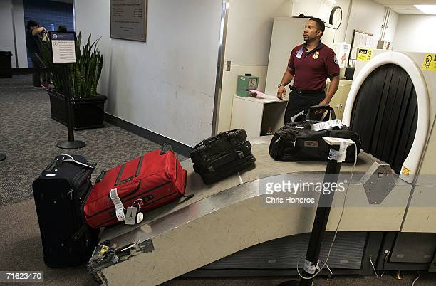 Transportation Security Administration screener operates the checked luggage screening machine at RaleighDurham International Airport August 10 2006...