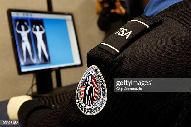 Transportation Security Administration Security Officer Nyamsi Tchapleu looks at images created by a 'backscatter' scanner during a demonstration at...