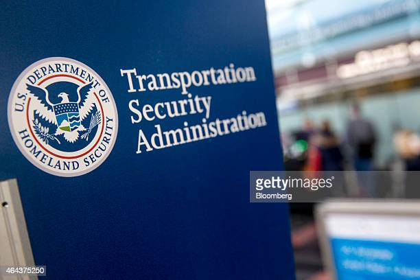 A Transportation Security Administration sign stands at Ronald Reagan National Airport in Washington DC US on Wednesday Feb 25 2015 Financing for the...
