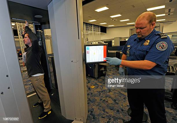 S Transportation Security Administration supervisor Nick Fox and another TSA employee demonstrate an advanced image technology millimeter wave...