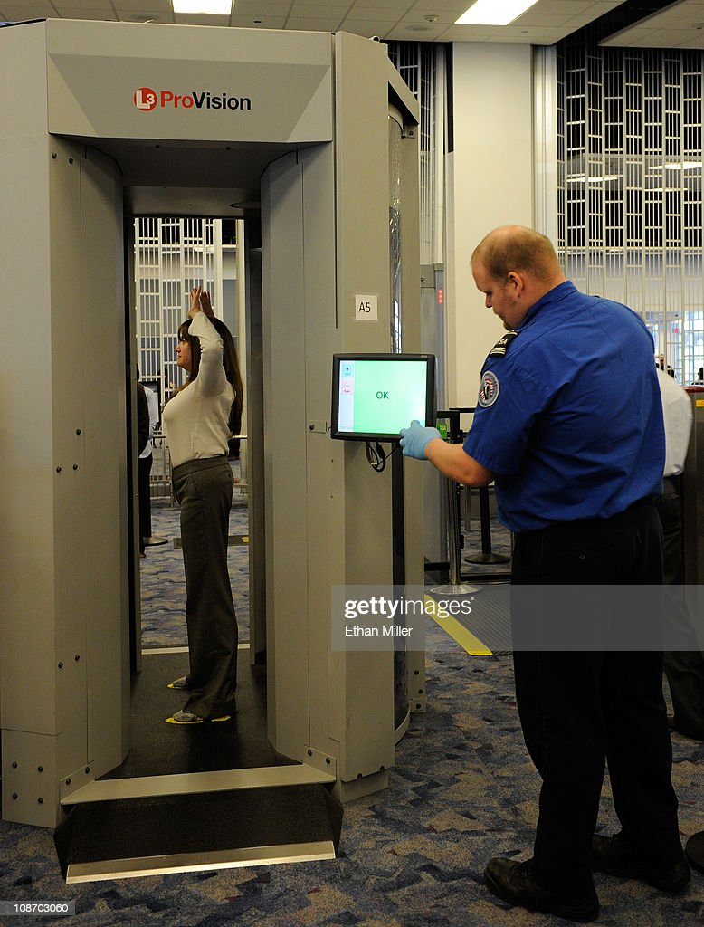 tsa tests new body scanning technology at vegas airport photos and u s transportation security administration supervisor nick fox r and another tsa employee demonstrate an