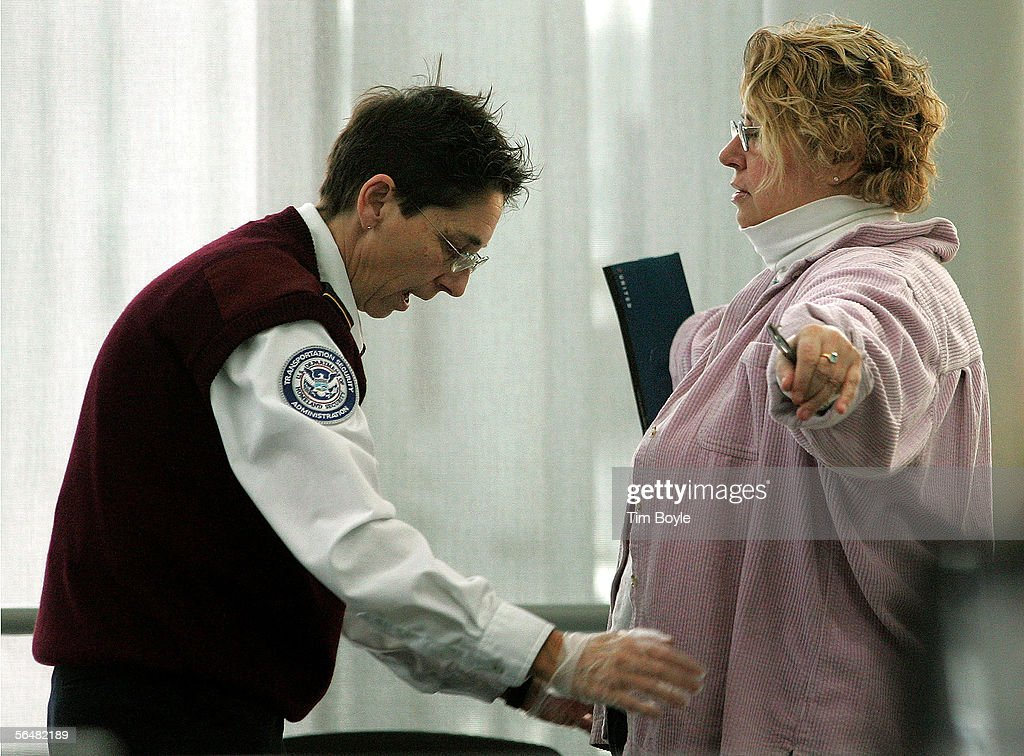 A Transportation Security Administration (TSA) worker checks a traveler at a security post at O'Hare International Airport December 22, 2005 in Chicago, Illinois. According to the TSA, security measures will be stepped up during the busy holiday travel season when, in an estimation by AAA, 63.5 million Americans plan to travel 50 miles or more.