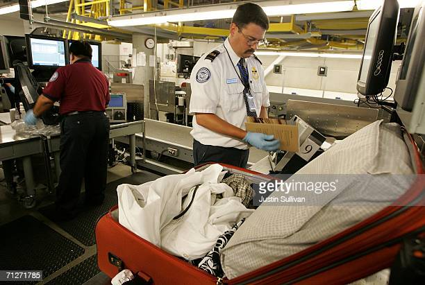Transportation Security Administration worker hand searches a bag at the Oakland International Airport June 22 2006 in Oakland California The TSA is...