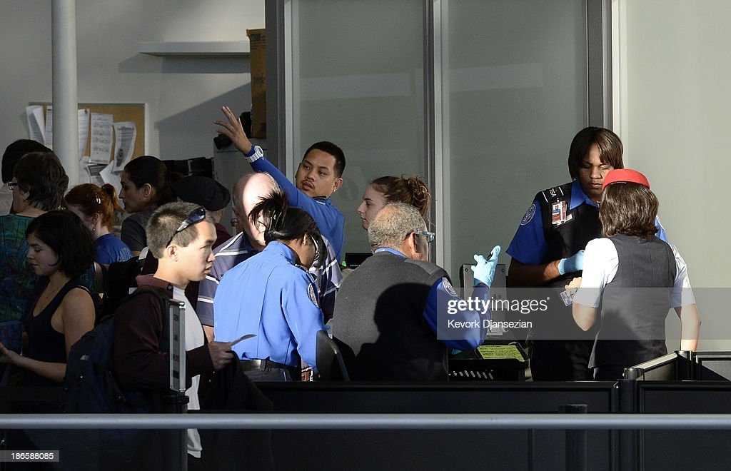 Transportation Security Administration workers screen passengers as normal operations slowly returns at Los Angeles International Airport (LAX) after a shooting incident November 1, 2013 in Los Angeles, California. A man identified as Paul Ciancia reportedly pulled out an assault rifle in Terminal 3 of the airport and shot his way through security, killing one Transportation Security Administration (TSA) worker and wounding several others before being shot himself.