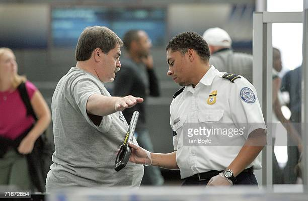 Transportation Security Agency checks a traveler with a wand in Terminal One at O'Hare International Airport August 18 2006 in Chicago Illinois...