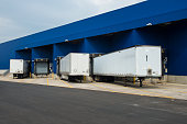 Transportation service delivery station. Big distribution warehouse with gates for loads and trucks