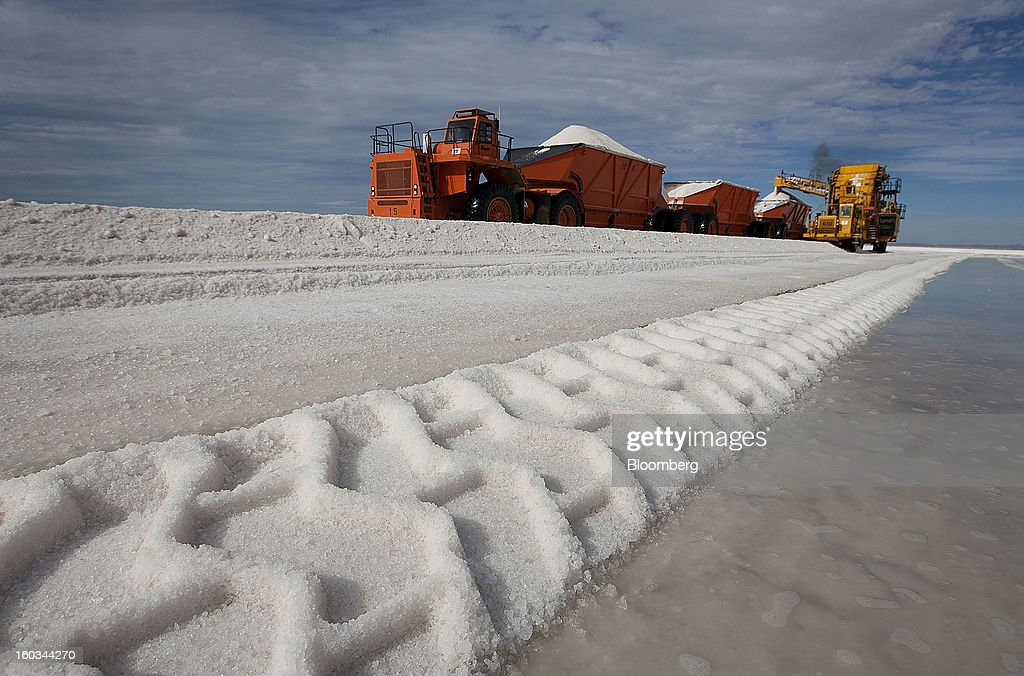 A transportation truck is loaded with salt harvested from a crystallization pond at the Exportadora de Sal (ESSA) harvest fields in Guerrero Negro, Mexico, on Wednesday, Jan. 24. 2013. Exportadora de Sal (ESSA), a joint venture between Fidecomiso Mining Development Corporation and Mitsubishi, is one of the leading producers and suppliers of salt for the chlorine-alkali industry in the Pacific Rim. Photographer: Susana Gonzalez/Bloomberg via Getty Images