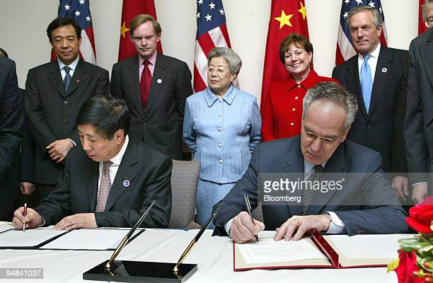 S Transportation Undersecretary Jeffrey Shane seated right and Chinese Ministry of Communication Vice Minister Hong Shanxiang seated left sign a...