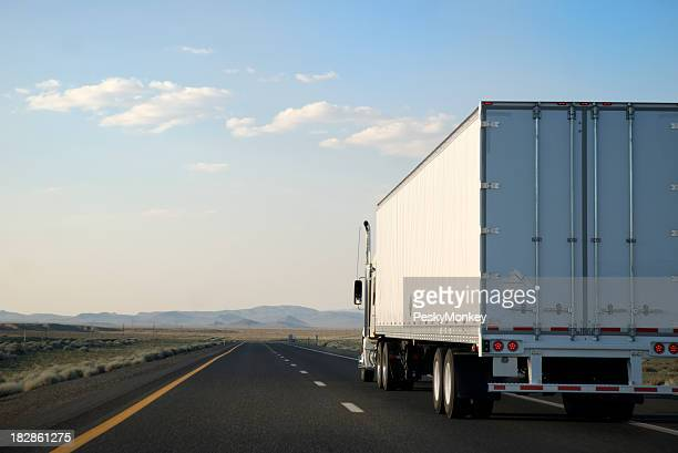 Transporting White Trailer Truck Driving on the Open Road Highway