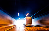 Transports Truck Driving in Tunnel