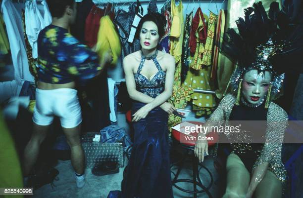 Transsexual and transvestite performers take a break backstage before a cabaret show at a nightclub off Silom Road in downtown Bangkok Transsexuals...