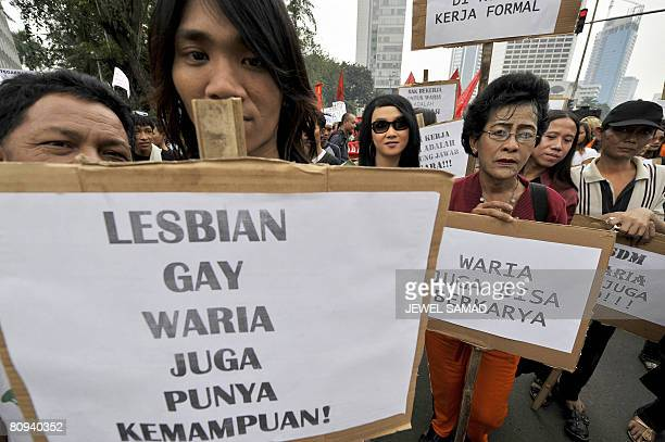 Transsexuals and gays display palacards reading 'Lesbian Gay have skills too' as they take part in a demonstration to mark May Day in Jakarta on May...