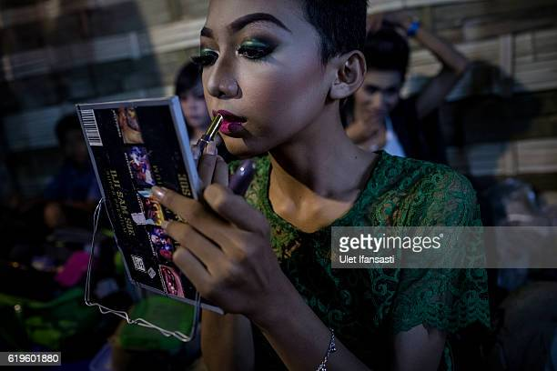 A transvestite Avi applies make up in the backstage before perform a traditional dance opera known as Ludruk on October 29 2016 in Surabaya Indonesia...