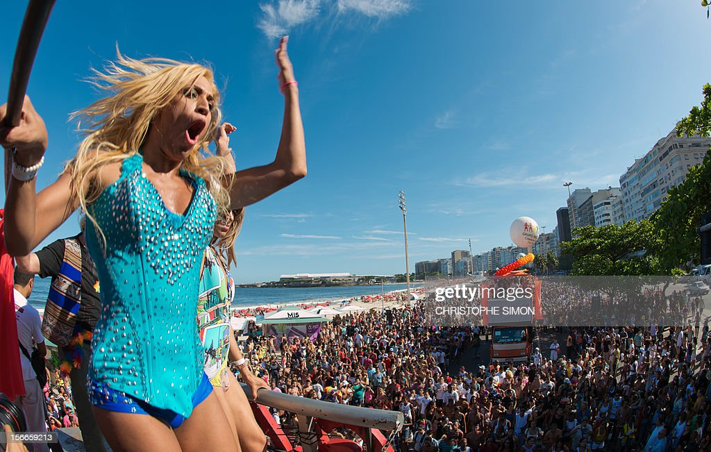 A transvestite dances on a float during the gay pride parade at Copacabana beach in Rio de Janeiro, Brazil on November 18, 2012. AFP PHOTO / CHRISTOPHE SIMON