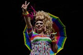 A transvestite gestures during a protest against the homophobic speech by Brazilian presidential candidate for the Labour Renewal Party Levy Fidelix...