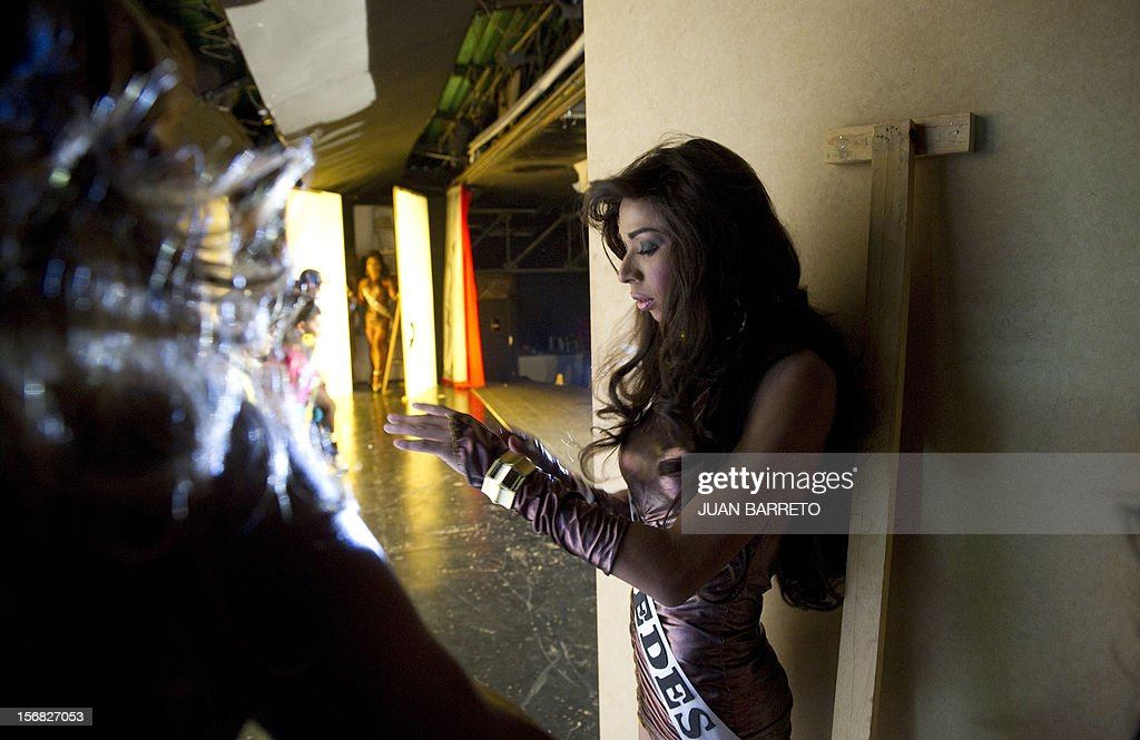 A transvestite gets ready for the catwalk during the Miss Venezuela Gay pageant in Caracas on November 21, 2012. AFP PHOTO/JUAN BARRETO
