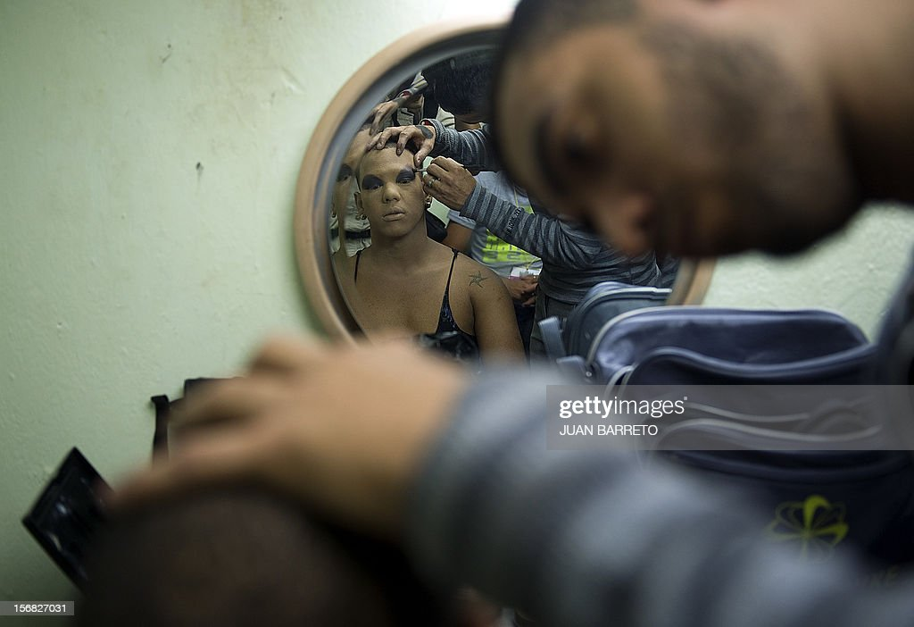 A transvestite is being made up before taking part in Miss Venezuela Gay pageant in Caracas on November 21, 2012. AFP PHOTO