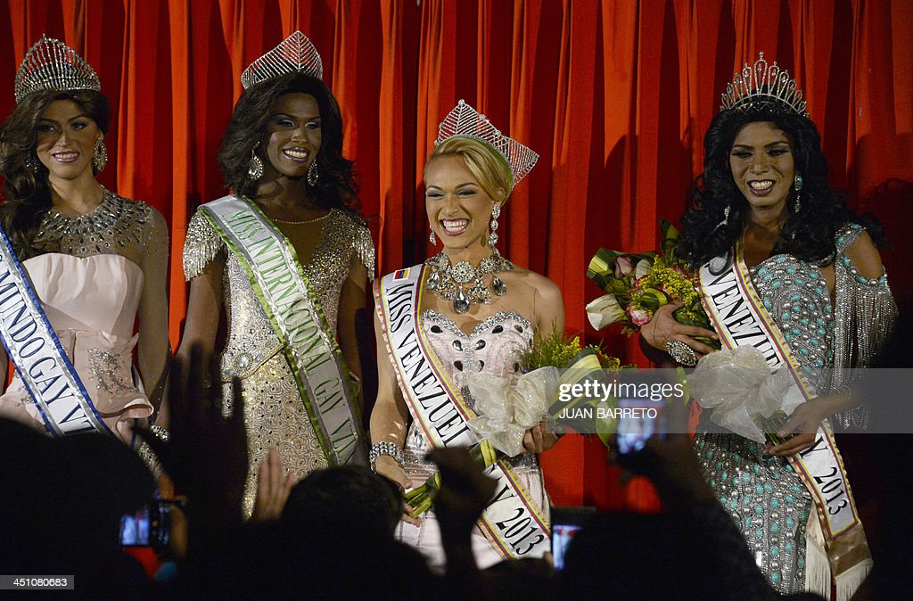 A transvestite known as Alejandro (C) celebrates after being declared winner of the Miss Venezuela Gay pageant, in Caracas on November 20, 2013.