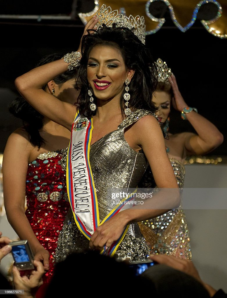 A transvestite known as Daniel celebrates after being declared winner of the Miss Venezuela Gay pageant, in Caracas on November 22, 2012. AFP PHOTO