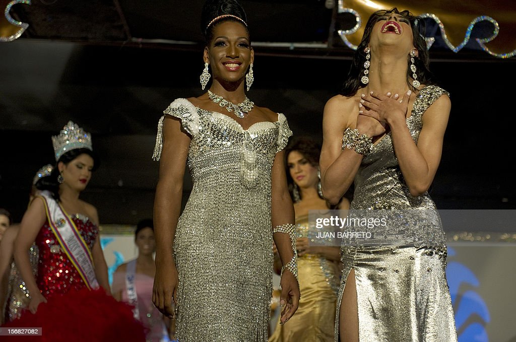 A transvestite known as Daniel (R) celebrates after being declared winner of the Miss Venezuela Gay pageant, in Caracas on November 22, 2012. AFP PHOTO