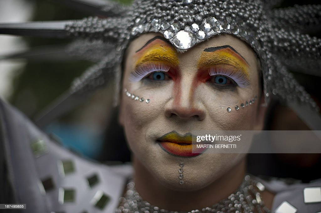 A transvestite poses for a picture in Plaza Bulnes, in Santiago, during the VIII Gay Pride Parade, on November 9, 2013.