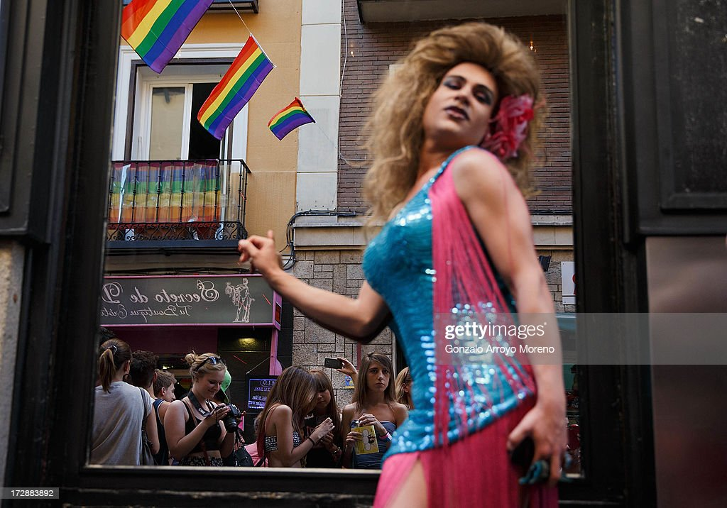 A transvestite poses in front of people in Chueca neigborhood during the Madrid Gay Pride Festival 2013 on July 4, 2013 in Madrid, Spain. According to a new Pew Research Center survey about homosexual acceptance across the World, Spain is the top of gay friendly countries with an 88 percent acceptance.