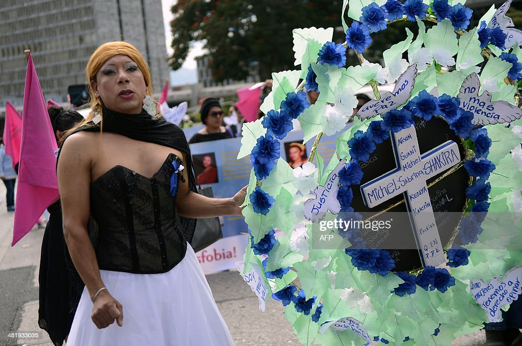 A transvestite takes part in a march during the commemoration of the International Day for the Elimination of Violence Against Women, in Guatemala City on November 25, 2013. So far this year, 696 women have died due to violent events in Guatemala. AFP PHOTO/Johan ORDONEZ