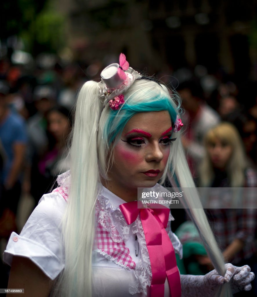 A transvestite walks in Plaza Bulnes, in Santiago, during the VIII Gay Pride Parade, on November 9, 2013.
