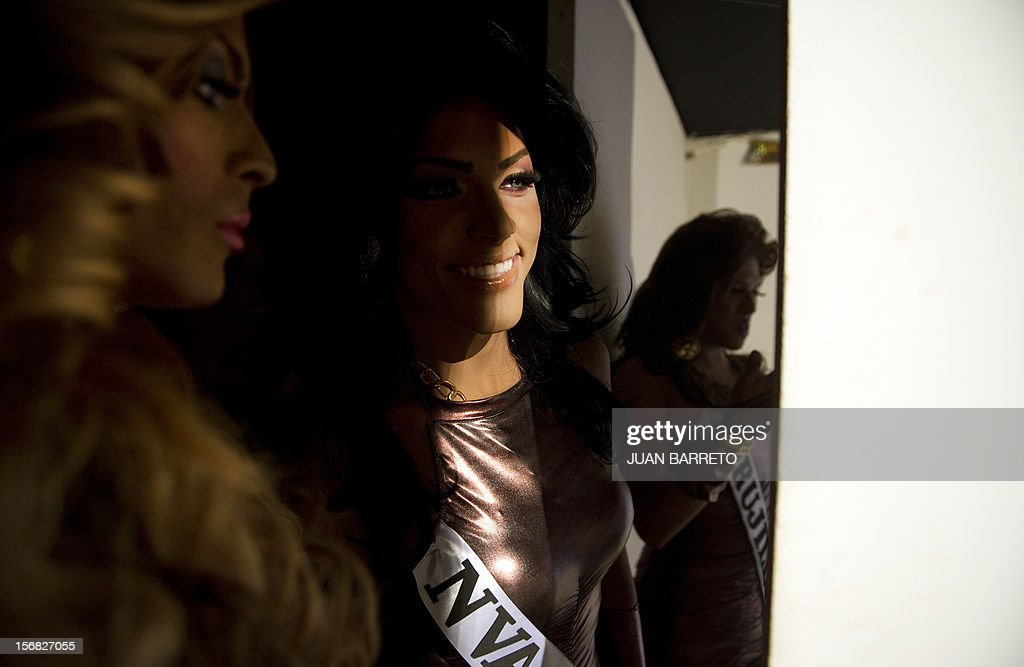 Transvestites get ready for the catwalk during the Miss Venezuela Gay pageant in Caracas on November 21, 2012. AFP PHOTO/JUAN BARRETO