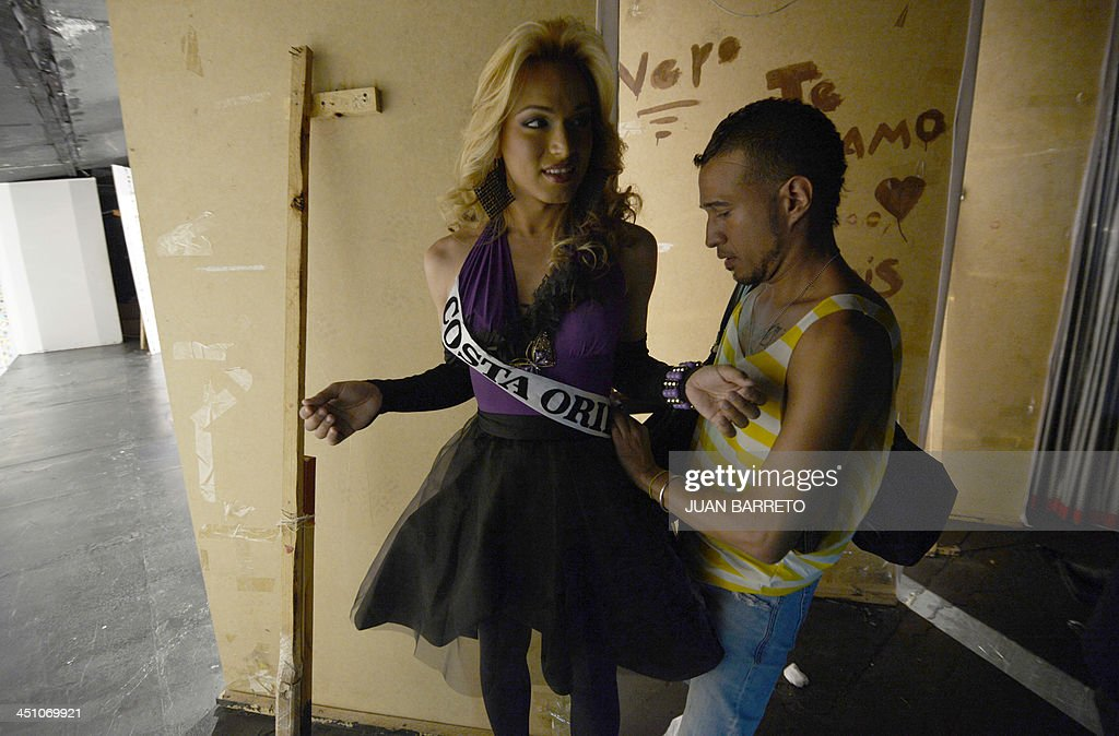 Transvestites get ready for the catwalk during the Miss Venezuela Gay pageant in Caracas on November 20, 2013.