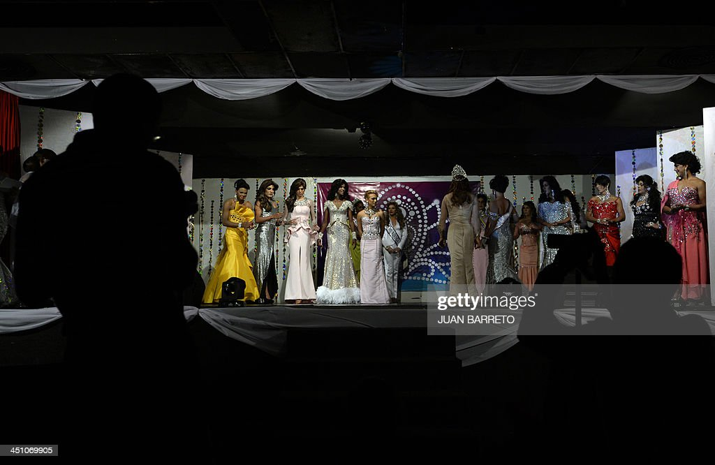 Transvestites on the catwalk during the Miss Venezuela Gay pageant in Caracas on November 20, 2013.
