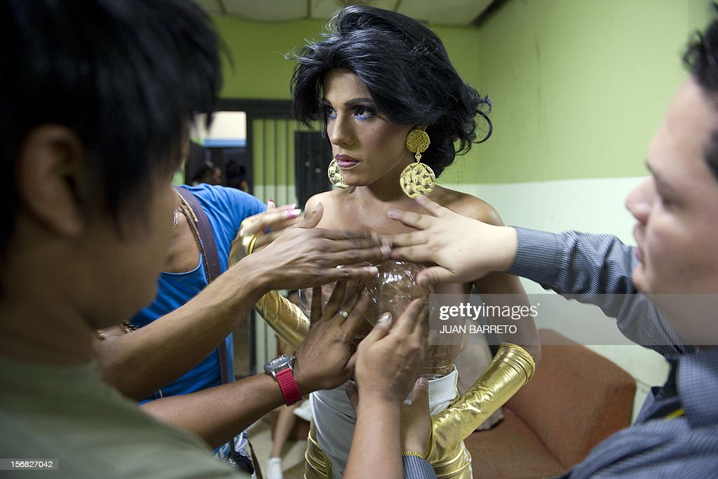 A transvetite is prepared to take part in Miss Venezuela Gay pageant in Caracas on November 21, 2012. AFP PHOTO