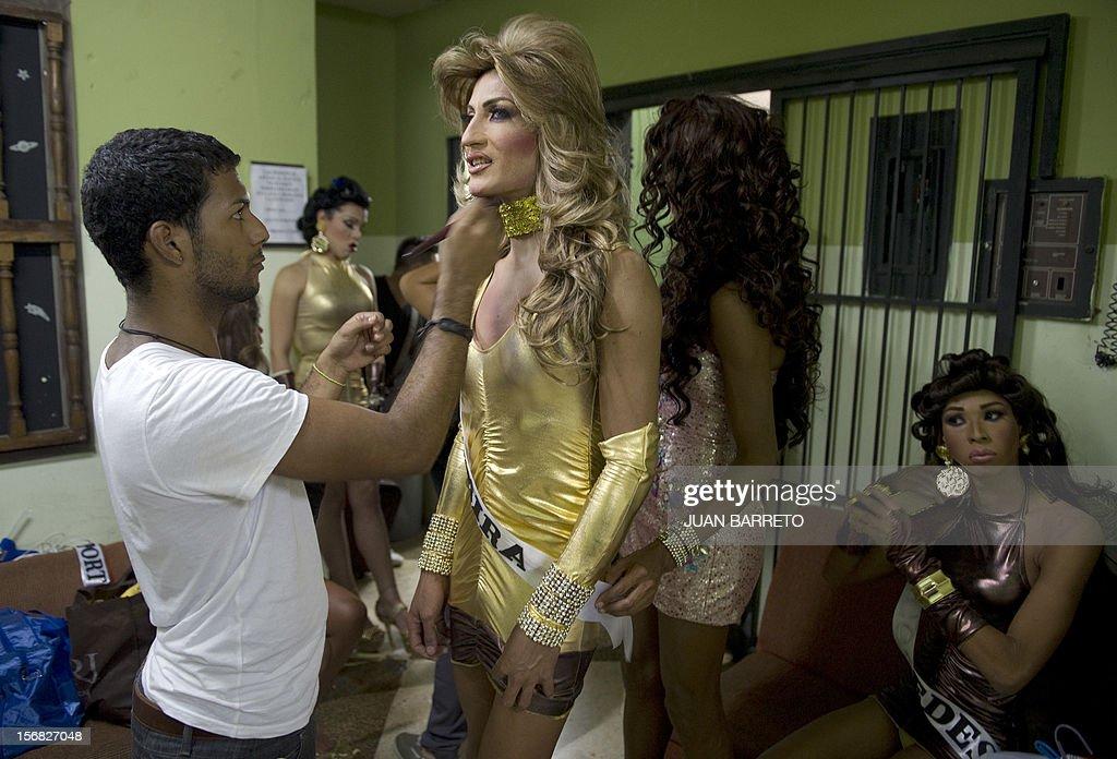 A transvetite is prepared to take part in Miss Venezuela Gay pageant in Caracas on November 21, 2012. AFP PHOTO/JUAN BARRETO