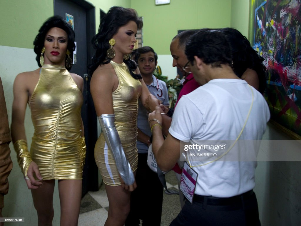Transvetites are prepared to take part in Miss Venezuela Gay pageant in Caracas on November 21, 2012. AFP PHOTO/JUAN BARRETO