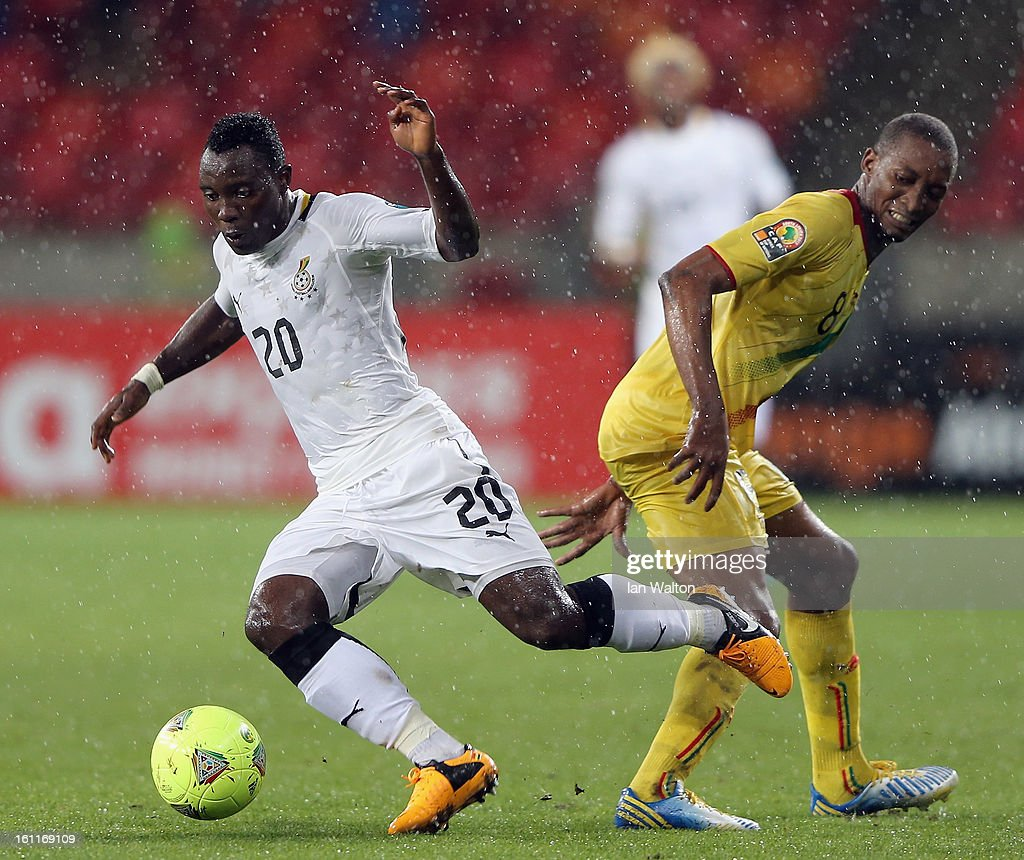 Traore Kililou Mohamed of Mali challenges Asamoah Kwadwo of Ghana during the 2013 Africa Cup of Nations Third Place Play-Off match between Mali and Ghana on February 9, 2013 in Port Elizabeth, South Africa.