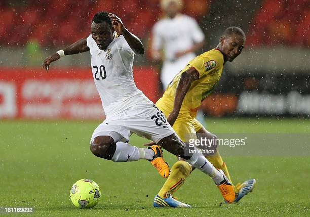 Traore Kililou Mohamed of Mali tackles Asamoah Kwadwo of Ghana during the 2013 Africa Cup of Nations Third Place PlayOff match between Mali and Ghana...