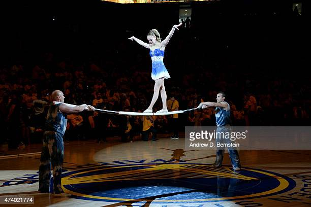 A trapeze artist performs at halftime during a game between the Houston Rockets and Golden State Warriors in Game One of the Western Conference...