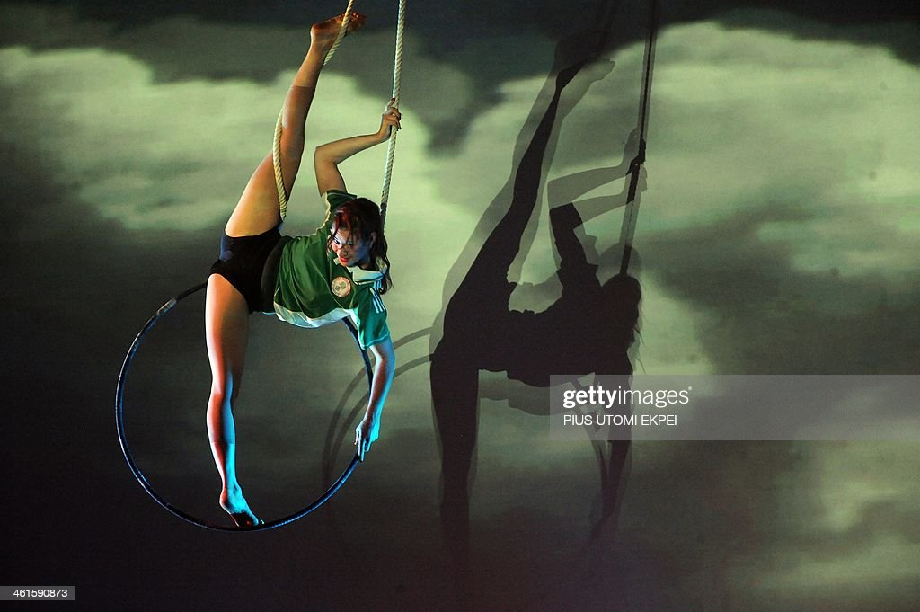 Trapeze dancer Marelke Koch thrills the audience with aerial silk and aerial straps during the CAF African Footballer of the Year Award in Lagos on...