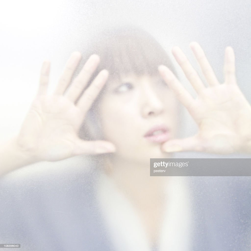 trapped behind the glass : Stock Photo