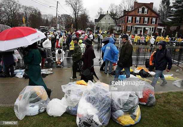 Trash bags full of rain ponchos and warm up clothes sit near the start of the 111th Boston Marathon on April 16 2007 in Hopkinton Massachusetts