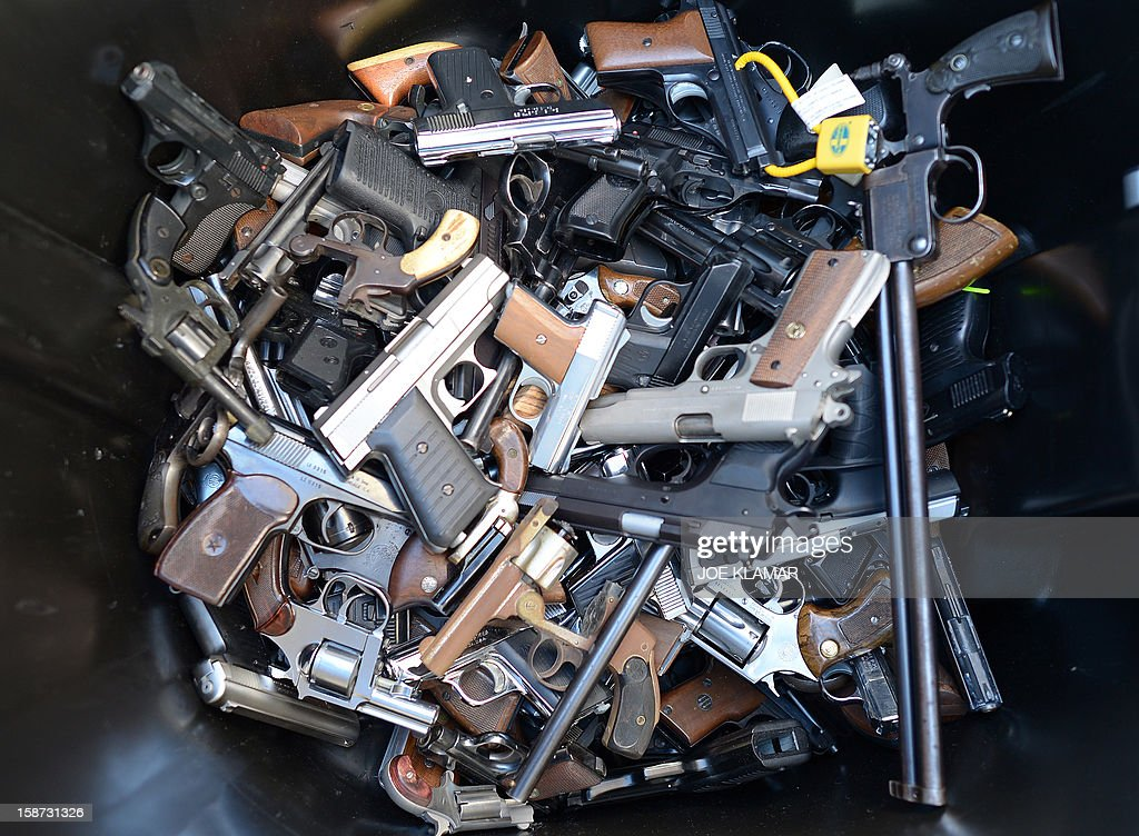 A trash bin full of handguns collected during the LAPD Gun Buyback Program event in Van Nuys area, north of Los Angeles, on December 26, 2012. By noon LAPD collected more then 420 handguns, rifles and shotguns such as TEC-9, Assault rifle, Uzi, WWI rifle. Apart from it, there are 16 assault weapons and some vintage weapons. One is dated 1895.