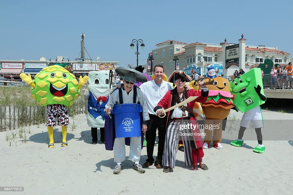 Trash Buster (Mark Soifer), Ocean City Mayor, Jay Gillian and The Pirate (Doug Jewell) and Mascots watch and take part in the Unlocking Of The Ocean and The Business Persons Plunge on May 27, 2016 in Ocean City, New Jersey.