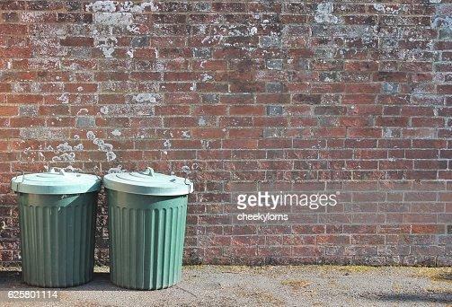 trash can dustbin trashcan rubbish bins brick wall copy space : Stock Photo
