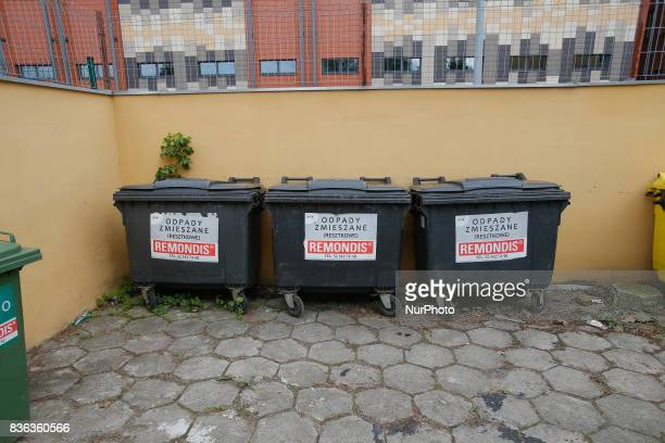 Trash containers are seen near a residential building on 19 August 2017