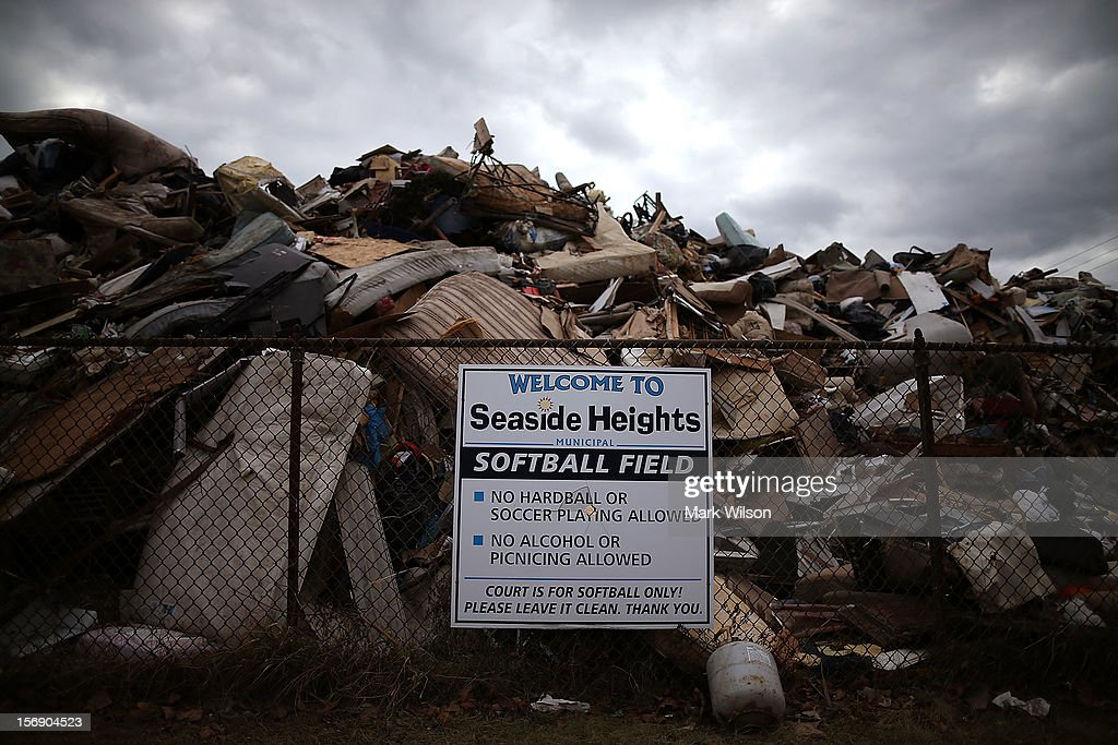 Trash from damages done by Superstorm Sandy is piled up in the towns softball field, on November 24, 2012 in Seaside Heights, New Jersey. New Jersey Gov. Christie estimated that Superstorm Sandy will cost New Jersey $29.4 billion in damage and economic losses.