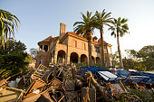 A trash heap covers the grounds outside the Selay Mansion in historic Galveston as residents still struggle to cleanup the mess more than two weeks...