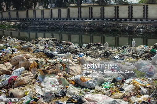 Trash in an Egyptian water canal : Stock Photo