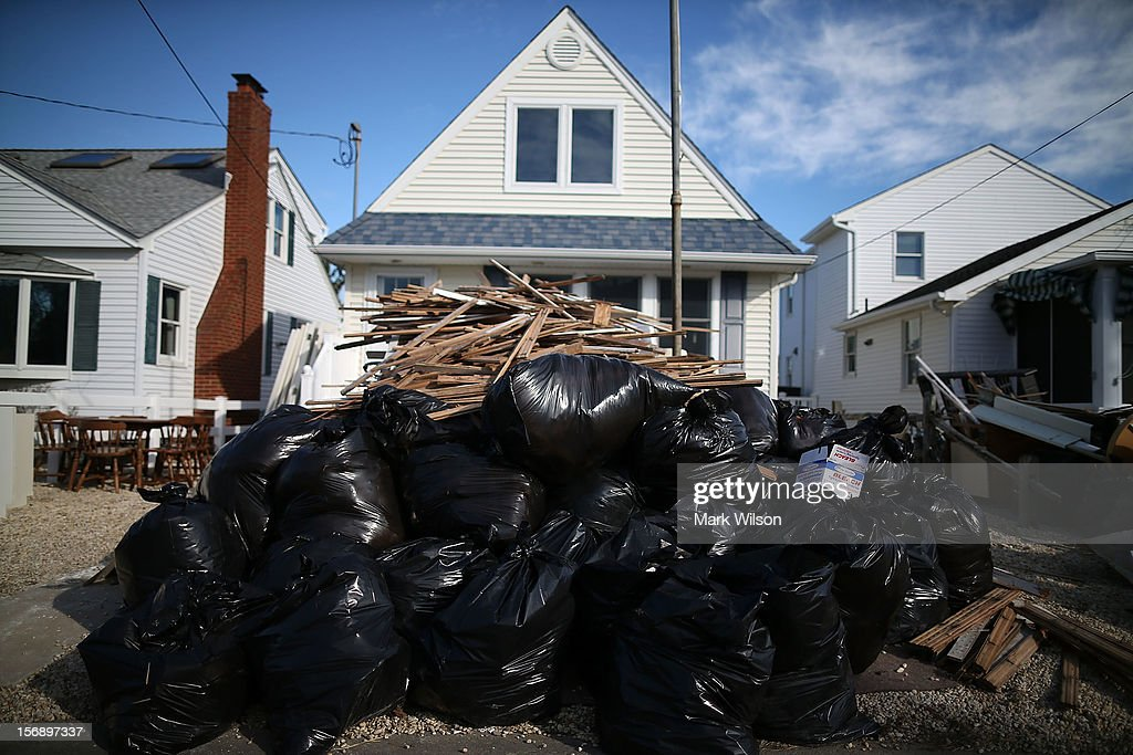 Trash is piled up in front of a house that was flooded by Superstorm Sandy, on November 24, 2012 in Long Beach Island, New Jersey. New Jersey Gov. Christie estimated that Superstorm Sandy will cost New Jersey $29.4 billion in damage and economic losses.