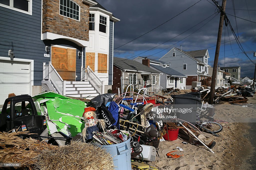 Trash is piled up in front of homes damaged by Superstorm Sandy, on November 24, 2012 in Ortley Beach, New Jersey. New Jersey Gov. Christie estimated that Superstorm Sandy will cost New Jersey $29.4 billion in damage and economic losses.